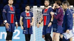 Les handballeurs du PSG : Kamil Syprzak, Elohim Prandi et Luka Karabtic (de gauche à droite) lors du quart de finale aller de la Ligue des champions à Kiel, le 12 mai 2021. (FRANK MOLTER / DPA)