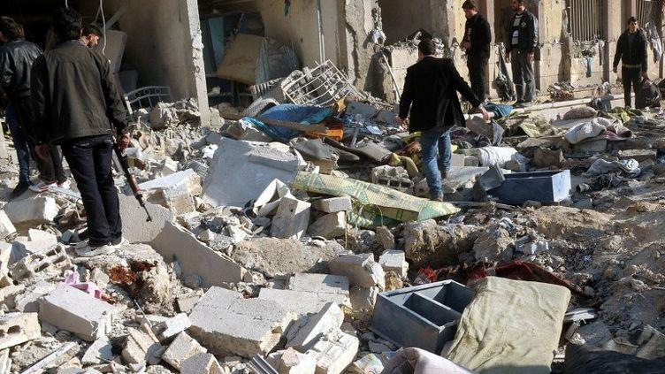 La double explosion est survenue à l'université d'Alep, en Syrie, mardi 15 janvier 2013, dans une zone contrôlée par l'armée régulière. ( SANA / AFP)