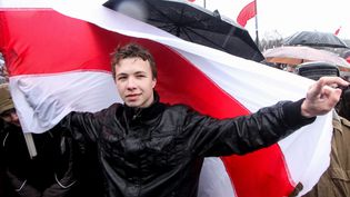 L'opposant Roman Protassevitch pris en photo le 25 mars 2012 lors d'une manifestation à Minsk (Biélorussie). (STR / AFP)