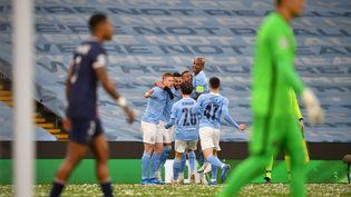 La joie des joueurs de Manchester City après l'ouverture du score de Mahrez. (PAUL ELLIS / AFP)