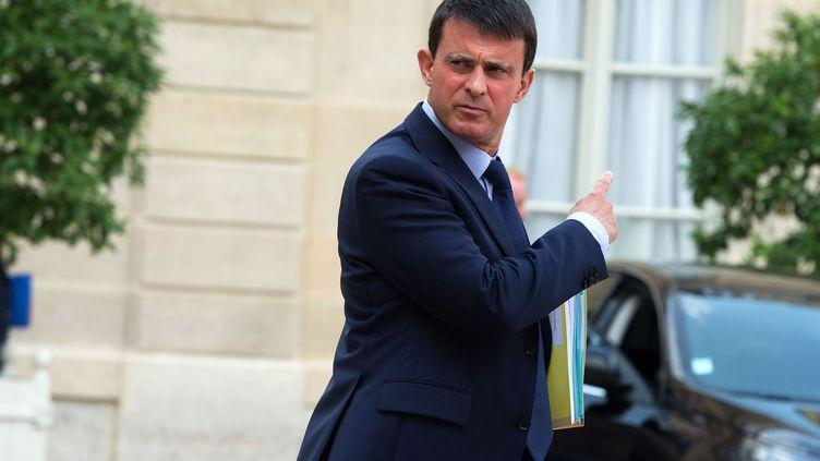 Le ministre de l'Intérieur, Manuel Valls, dans la cour de l'Elysée, le 28 août 2013. (PDN / SIPA)