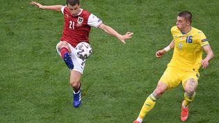 L'Autriche est pour l'instant qualifiée en huitièmes de finale. (MIHAI BARBU / POOL)