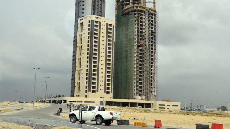 Sur Eko Atlantic (quartier de Lagos au Nigeria), vendu comme le plus grand projet immobilier d'Afrique, la construction frénétique a fortement ralenti... en attendant des jours meilleurs. (PIUS UTOMI EKPEI / AFP)