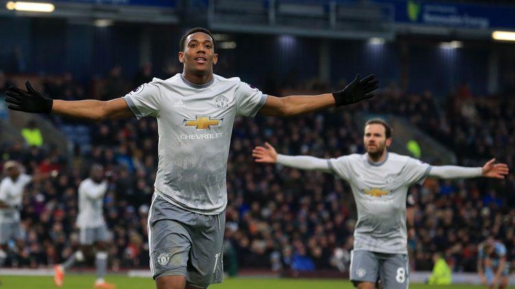 L'attaquant de Manchester United, Anthony Martial, délivre les siens (LINDSEY PARNABY / AFP)