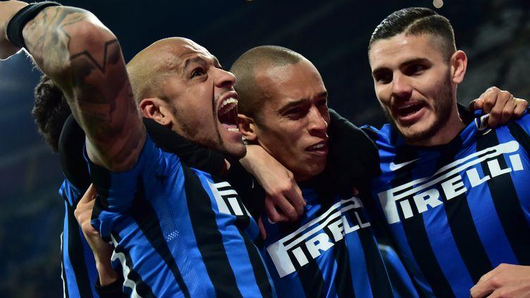 Joao Miranda, Mauro Icardi et Felipe Melo fêtent leur victoire (GIUSEPPE CACACE / AFP)
