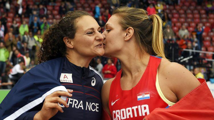 Mélina Robert-Michon n'a pas pu passer l'obstacle Sandra Perkovic (FRANCK FIFE / AFP)