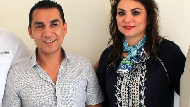 L'ancien maire d'Iguala (Mexique), Jose Luis Abarca, et son épouse Maria de los Angeles Pineda, le 3 juillet 2014. (JESUS GUERRERO / AFP)
