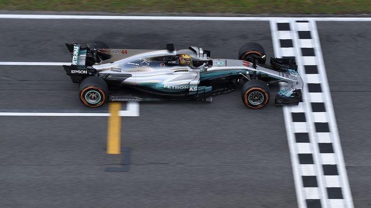 Le pilote britannique Lewis Hamilton (LLUIS GENE / AFP)