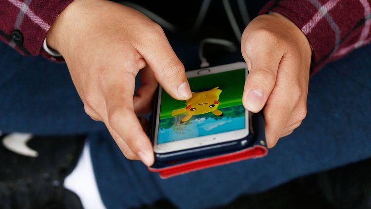 Où se cache le Pokémon ? (BRENDON THORNE / GETTY IMAGES ASIAPAC)