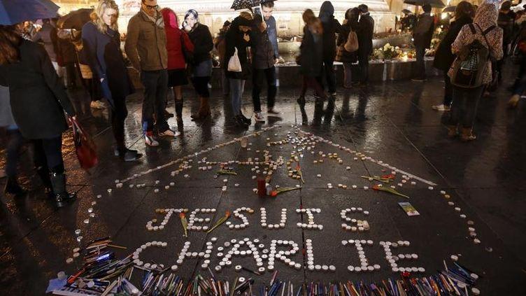 Un hommage aux attentats de Charlie Hebdo dans les rues de Paris en janvier 2015. (© PASCAL ROSSIGNOL / REUTERS )