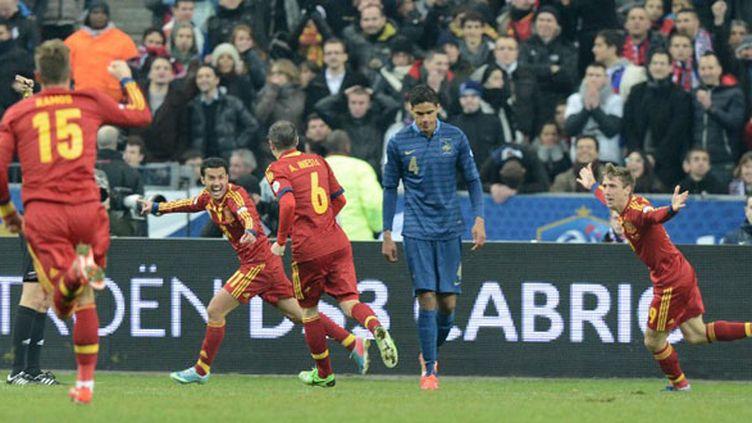 Les Espagnols célèbrent l'ouverture du score (FRANCK FIFE / AFP)
