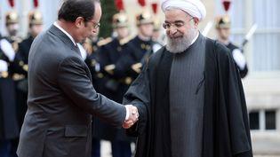 François Hollande reçoit le président iranien Hassan Rohani, à l'Elysée, le 28 janvier 2016. (STEPHANE DE SAKUTIN / AFP)