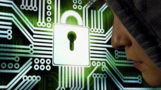 Illustration d'un hacker qui tente de s'infiltrer dans un réseau informatique, à Nancy (Lorraine), le 10 octobre 2016. (MAXPPP)