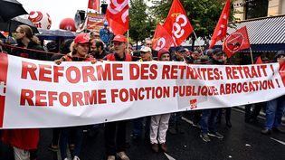 A l'appel de la CGT, Solidaires, l'Unsa et la FSU, des manifestants défilent à Paris, le 24 septembre 2019, contre la réforme des retraites. (MUSTAFA YALCIN / ANADOLU AGENCY/ AFP)