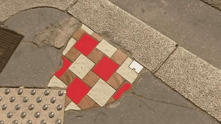 Une des productions d'Ememem sur un trottoir de Lyon  (France 3/ Culturebox)