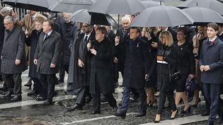 Le couple Macron entouré d'Angela Merkel et Justin Trudeau, sur les Champs-Elysées, le 11 novembre 2018. (KAY NIETFELD / AFP)