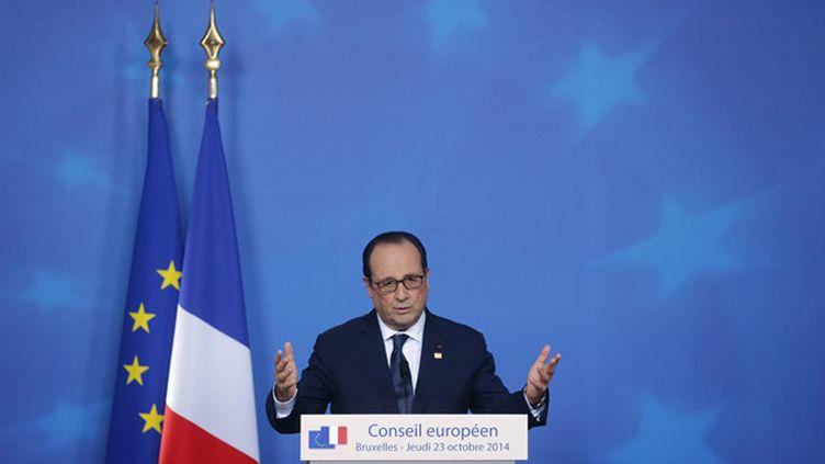 (François Hollande, lors du Conseil européen, hier © REUTERS/Christian Hartmann)