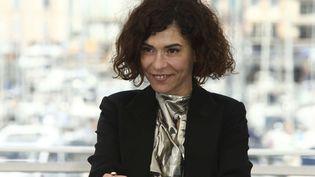 """L'actrice belge Lubna Azabal pose pour les photographes, le 20 mai 2019, à l'occasion de la présentation du film """"Adam"""",dans la section Un Certain Regard de la 72e édition du Festival de Cannes, où elle tient le premier rôle. (JOEL C RYAN/AP/SIPA / AP)"""