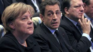 Angela Merkel et Nicolas Sarkozy lors d'un sommet européen en 2011 (JEAN-PAUL PELISSIER / POOL / AFP)