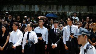 Des avocats et des travailleurs manifestent devant le ministère de la Justice à Hong Kong, le 7 août 2019. (THOMAS PETER / REUTERS)