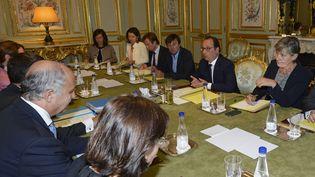 François Hollande préside une réunion ministérielle sur la COP21, le 25 août 2015 à Paris. (MIGUEL MEDINA / AFP)
