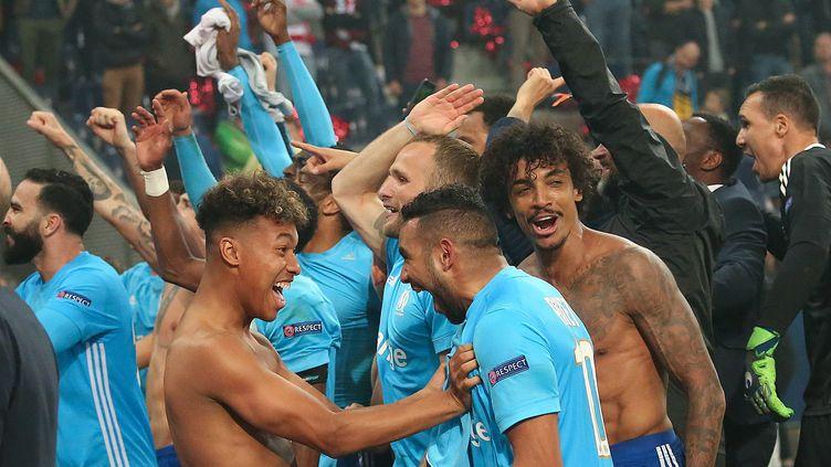 Les joueurs de l'Olympique de Marseille célèbrent la qualification. (DANIEL KRUG / APA)