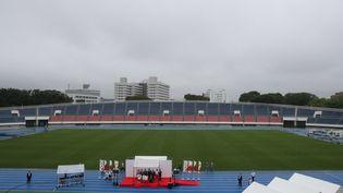 La cérémonie de relais de la flamme olympique lors de son arrivée à Tokyo (Japon), le 9 juillet 2021. (MIHO TAKAHASHI / YOMIURI / AFP)