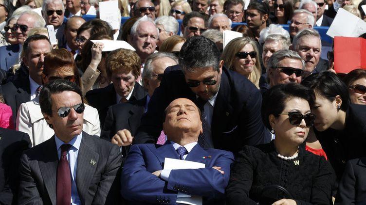 L'ancien président du Conseil italien, Silvio Berlusconi, assiste à la cérémonie d'inauguration ducentre George W. Bush à Dallas (Texas, Etats-Unis), le 25 avril 2013. (JASON REED / REUTERS)