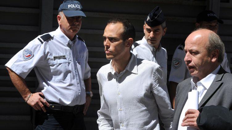 Rémy Di Grégorio (au centre), et son avocat Dominique Mattei (à droite), le 12 juillet 2012. (GERARD JULIEN / AFP)