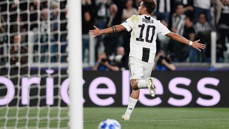 Paulo Dybala a inscrit un triplé pour la Juve  (MARCO BERTORELLO / AFP)
