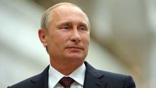 Le président russe Vladimir Poutine en déplacement à Minsk (Biélorussie), le 27 août 2014. (ALEXEI DRUZHININ / RIA NOVOSTI / AFP)