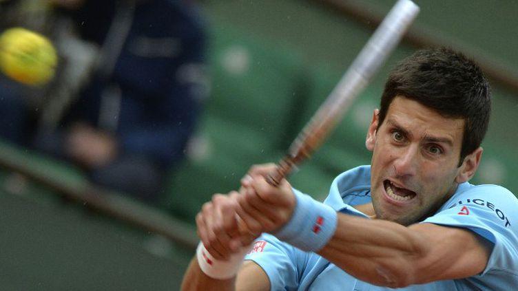 Novak Djokovic n'a pas laissé la moindre chance à Jérémy Chardy au 2e tour de Roland-Garros (MIGUEL MEDINA / AFP)