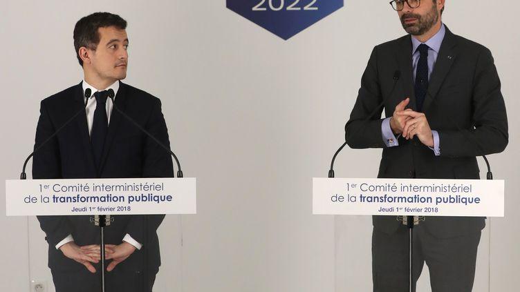 Gérald Darmanin et Edouard Philippe lors d'une conférence de presse, à Paris, jeudi 1er février 2018. (JACQUES DEMARTHON / AFP)