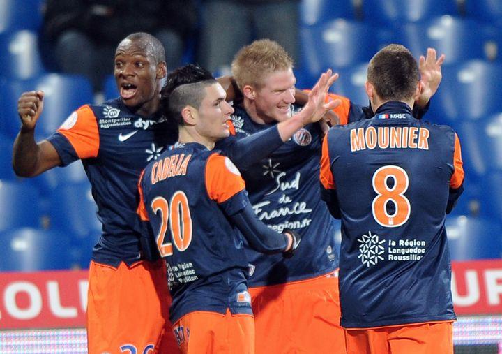 La joie des joueurs montpelliérains qui fêtent la victoire face à Lorient (2-0), le 12 janvier 2013. (PASCAL GUYOT / AFP)