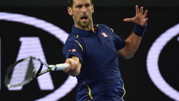 Novak Djokovic s'est imposé en trois sets face à l'Italien Andreas Seppi (6-1, 7-5, 7-6). Il affrontera Gilles Simon au prochain tour de l'Open d'Australie.  (PAUL CROCK / AFP)