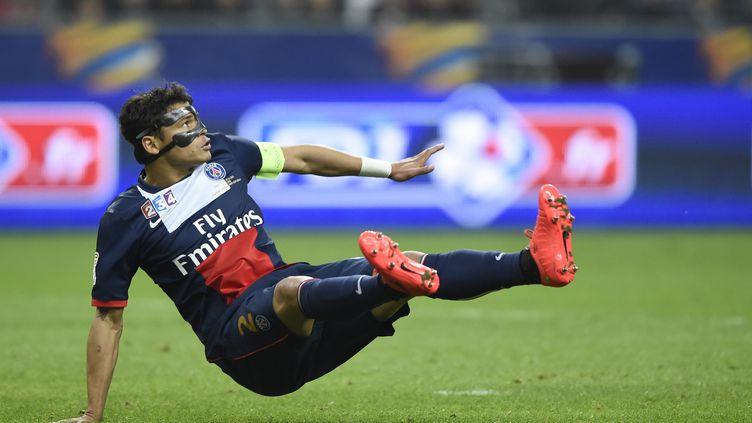 Le défenseur du PSG Thiago Silva lors de la finale de la Coupe de la Ligue face à Lyon, au Stade de France (Seine-Saint-Denis), le 19 avril 2014. (FRANCK FIFE / AFP)