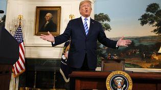 Le président américain, Donald Trump, lors de son allocution télévisée sur l'accord international sur le nucléaire iranien, le 8 mai 2018 à la Maison Blanche, à Washington (Etats-Unis). (MARTIN H. SIMON / CONSOLIDATED NEWS PHOTOS / AFP)