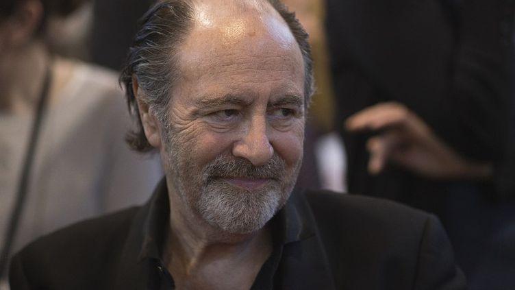 Le chanteur Michel Delpech, le 22 mars 2014 au Salon du Livre de Paris. (JOEL SAGET / AFP)