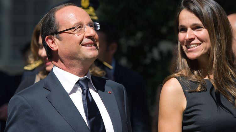 Le président de la République, François Hollande, et la ministre de la Culture, Aurélie Filippetti, en visite à Avignon pour le festival, le 15 juillet 2012. (BERTRAND LANGLOIS / AFP)