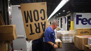 Employés de la FedEx (JOE RAEDLE / GETTY IMAGES NORTH AMERICA)