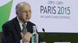 Laurent Fabius au Bourget, lors de la COP21, le 7 décembre 2015. (JACKY NAEGELEN / REUTERS)