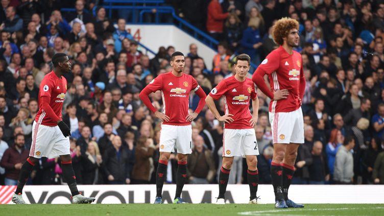 La déception des joueurs de Manchester United  (FACUNDO ARRIZABALAGA / EPA)