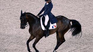 Le Français Nicolas Touzaint lors de l'épreuve du dressage équestre dans le concours complet par équipes,samedi31 juillet2021. (BEHROUZ MEHRI / AFP)