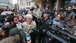Plusieurs des prévenus à la sortie du tribunal correctionnel de Gap (Hautes-Alpes) après leur jugement en première instance, le 13 décembre 2018. (MAXPPP)