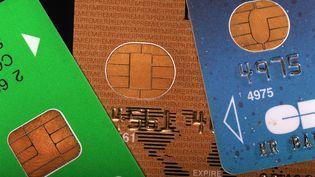Les cartes bancaires sont au coeur d'une bataille de hackers en Israël et en Arabie saoudite. (JEAN-PIERRE MULLER/AFP)