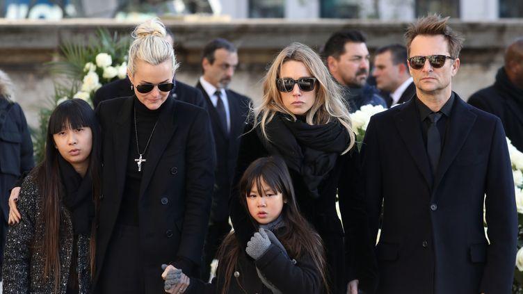 La famille Hallyday devant l'église de la Madeleine, à Paris, le 9 décembre 2017. (LUDOVIC MARIN / AFP)