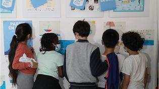 """Des enfants lors de l'inauguration de """"Partir en Livre"""". (BEAUX YEUX / CNL)"""