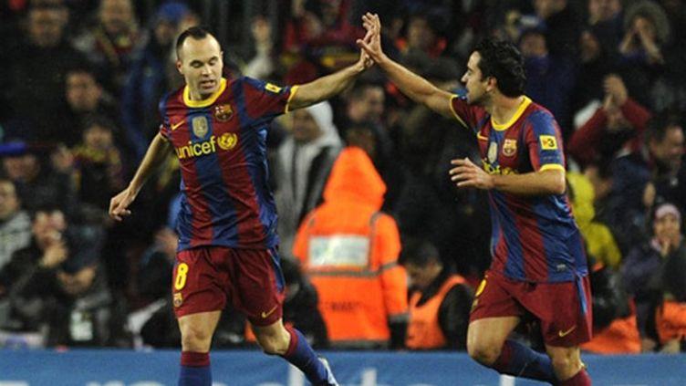 Xavi et Iniesta, les deux inspirateurs du jeu barcelonais et espagnol