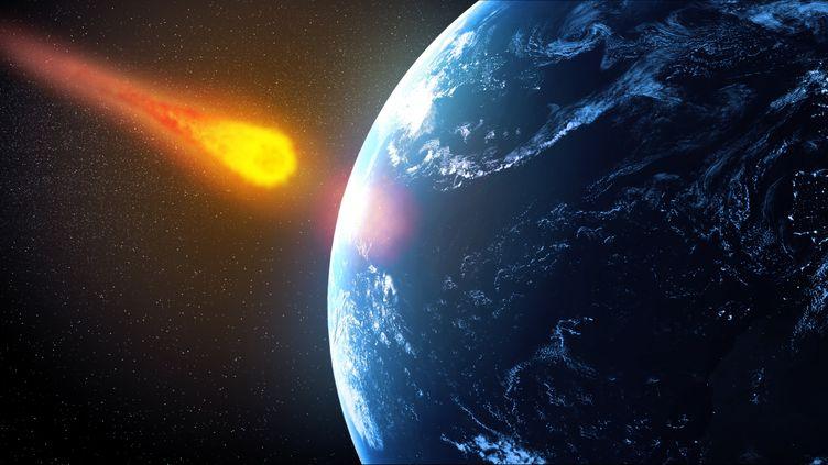 Vue d'artiste d'un astéroïde s'approchant de la Terre. (AWO / AFP)