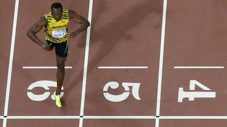"(Usain Bolt remporte le 200 m en 19'55"" © Reuters-Pawel Kopczynski)"